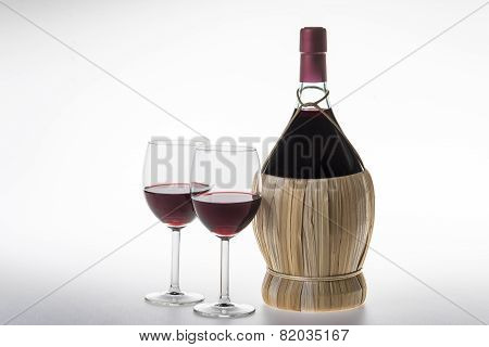 Old Bottle And Glasses Of Chianti Wine