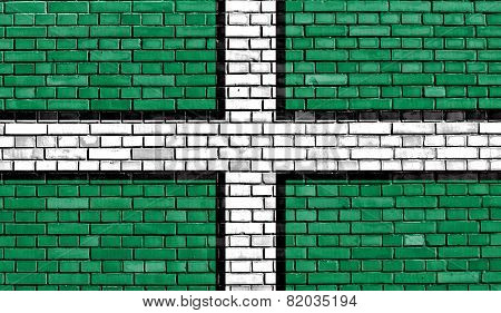 flag of Devon painted on brick wall