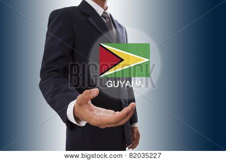 Businessman hand showing Guyana Flag