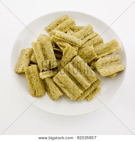 Corn Flake Cereal In A Pile Isolated Against A White Background