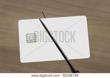 Scissors Cutting A Credit Or Debit Card