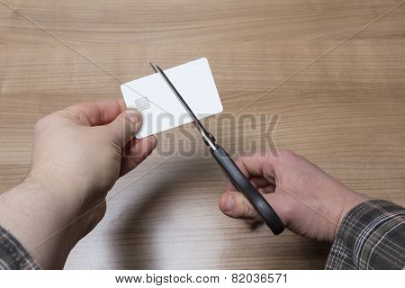 Hands Cutting A Credit Or Debit Card