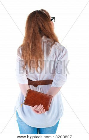Young Woman With  Notebook Looking At Wall.