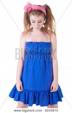 Ashamed Girl In  Dark Blue Dress.