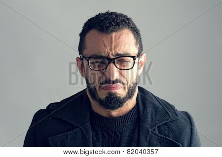 Man with sad expression isolated on grey backgrounf