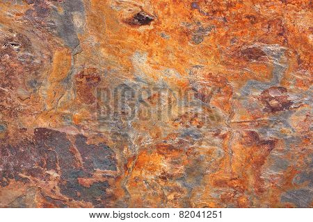 Abstract pattern of a stone slab in orange and blue