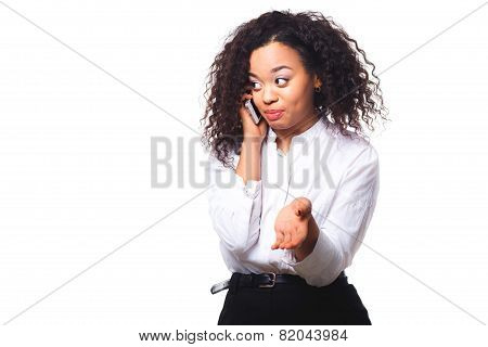 Beautiful African American woman talking on cell phone, isolated on white background