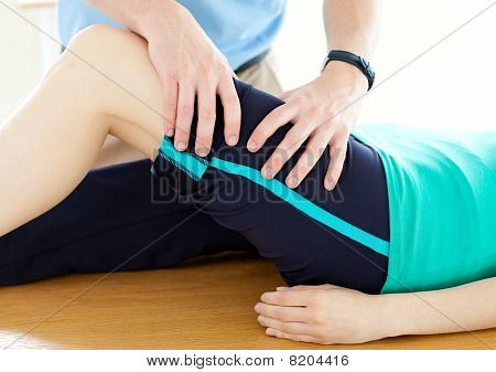 Therapist Doing Fitness Exercises With A Woman