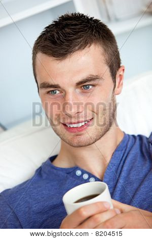 Attractive Man Drinking A Coffee