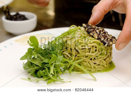 Homemade Pasta With Rocket Pesto And Pine Nuts Crusted Squid Ink