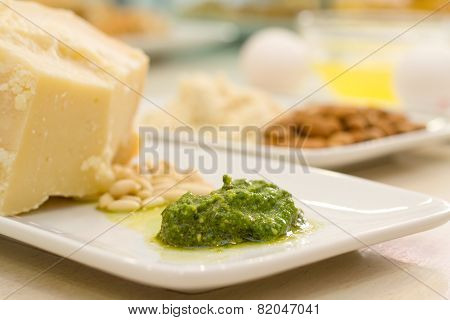 Food Ingredients With Pesto Sauce In The Focus In The Foreground