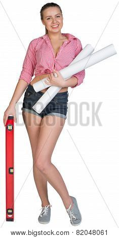 Woman holding drawing rolls and builders level