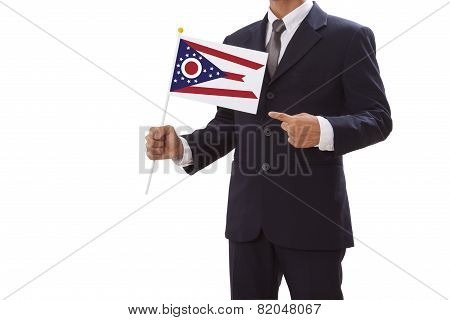 Businessman in suit holding Ohio State Flag