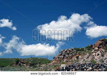 Armenian Mountains With Piles Of Old Stones