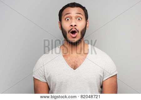 Astonished mixed race man looking at camera