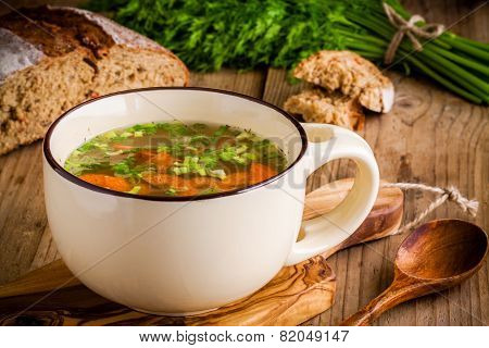 Vegetable Soup In A Cup On A Wooden Background