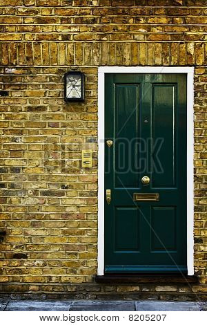 Green British door with doorbell