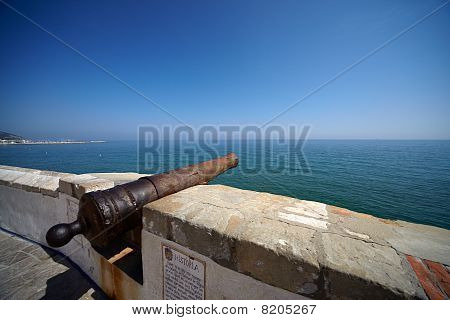 Old Spanish Cannon On The Quay Of The City Of Sitges