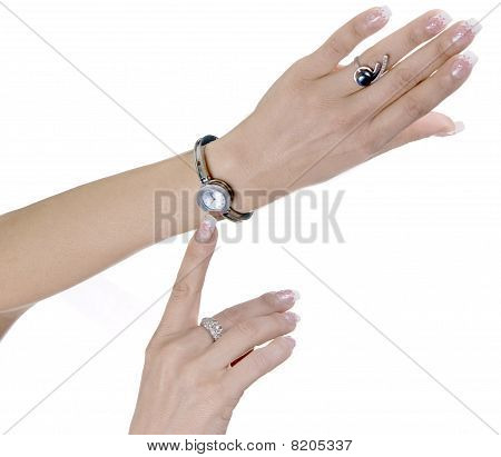 Female hands with hours and rings