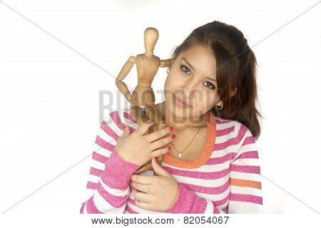 Cute Bolivian Girl With Wooden Mannequin