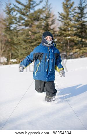 Child Boy Running In The Beautiful White Snow
