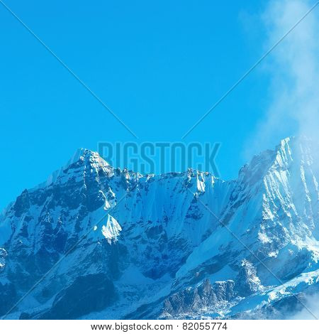 High Mountains Covered By Snow