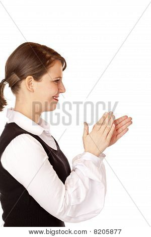 Attractive businesswoman claps with hands.