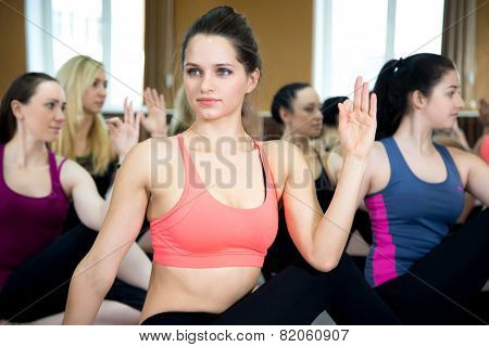 Group Of Yogi Females In Yoga Pose Ardha Matsyendrasana
