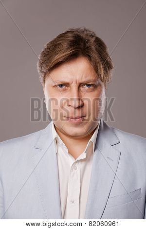 Angry Frowning Middle Age Man in Blue Jacket
