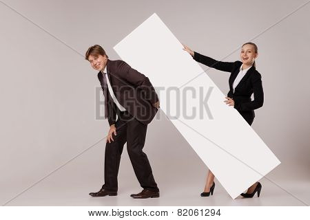 Business man and woman standing over blank banner