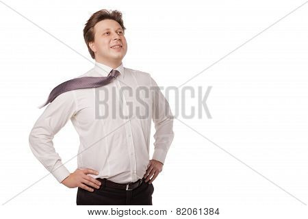 Young businessman smiling with blowing necktie