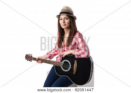 Closeup of young woman musician with guitar.