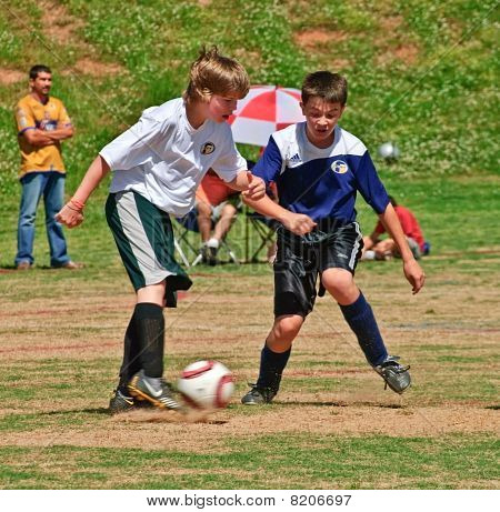 Boy's Soccer Fight For The Ball
