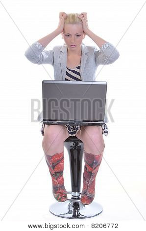 Woman With A Laptop And Sticks To Hands For A Head