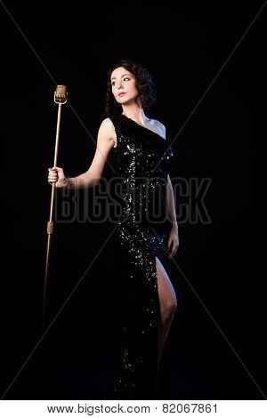 Beautiful Girl Singer Holding Golden Vintage Microphone