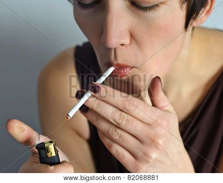 Beautiful Woman With A Cigarette.