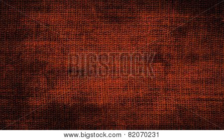 Grunge background of brown fabric texture