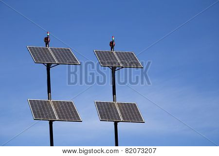 A Set Of Environment Solar Panel Poles With Blue Sky Background