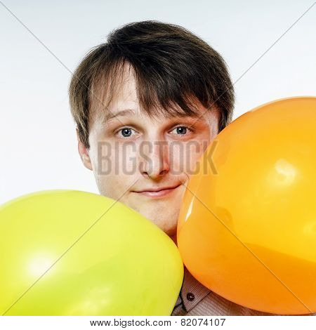 Young Caucasian Man Holding Yellow Air Balloons In His Hand
