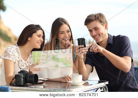Group Of Young Tourist Friends Consulting Gps Map In A Smart Phone
