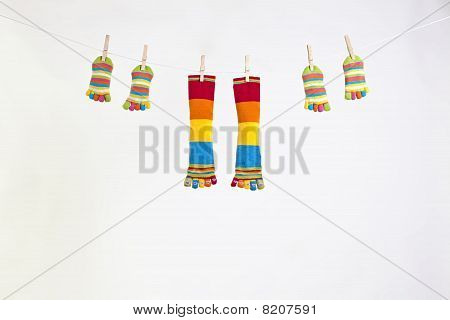 Socks On A Rope With Pegs