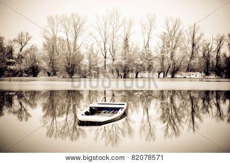 Abandoned Boat In A Frozen Lake