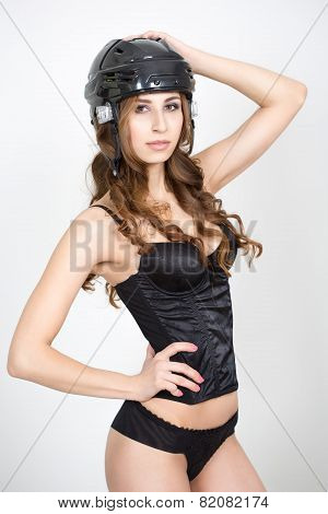 girl in a hockey helmet. in underwear
