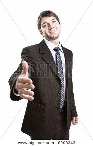 Business Agreement - Suit Man Offering Handshake