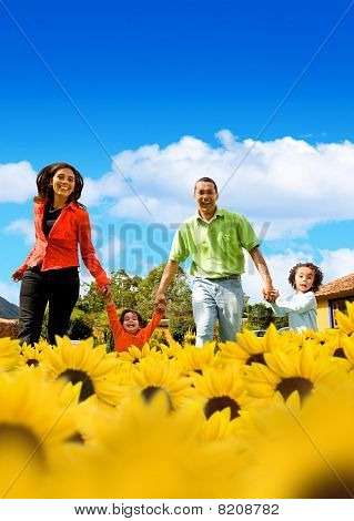 Family In A Field Of Sunflowers