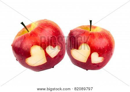 Two apples with hearts on a white background