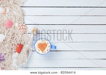 Cup Of Cappuccino And Net With Bottle