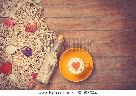 Cup And Net With Shells And Bottle