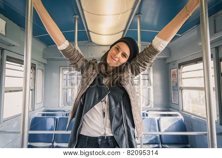 Pretty Girl Posing In A Metro Car