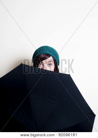 Young Pretty Woman With Green Hat, Smiling Eyes Behind Umbrella
